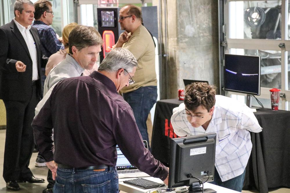 Attendees examine new connected device technology at Show&Tell
