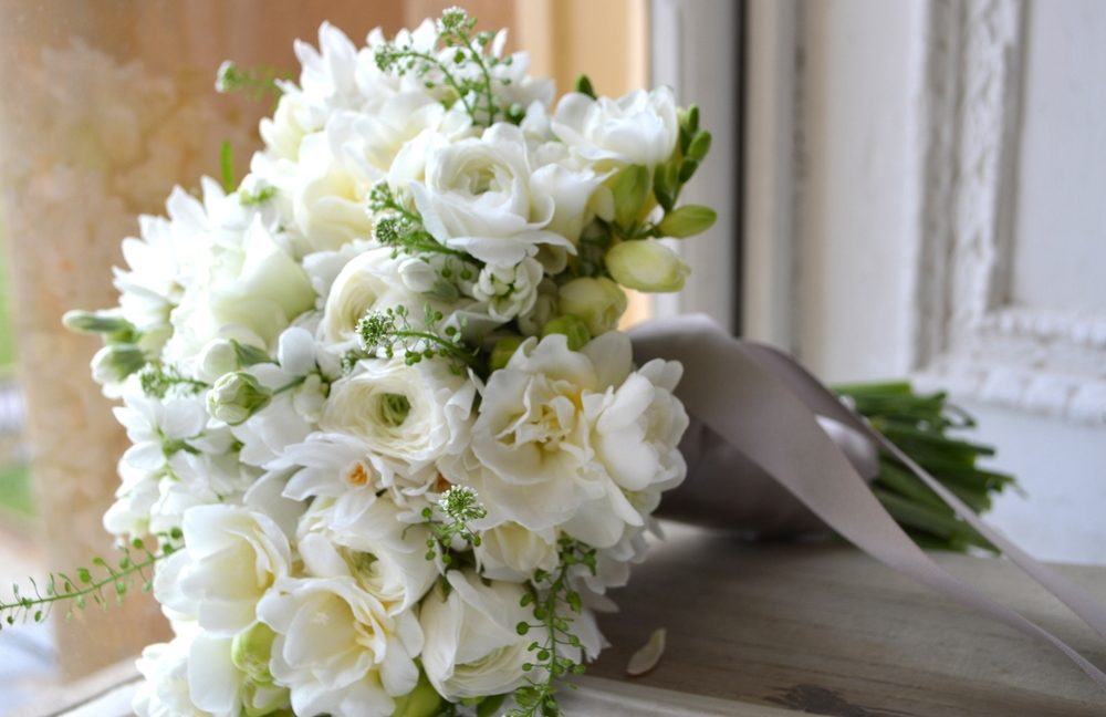 All white winter, wedding Bouquet with Ranuncula, Narcissi, Freesia & Hellebores