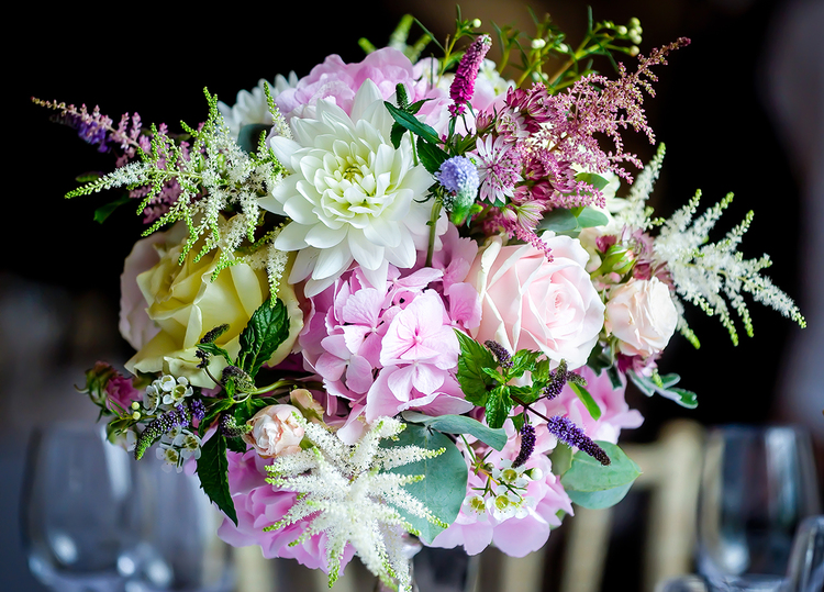 Wedding table centre with pink astilbe, hydrangea and cream roses, Dorton House, Bucks