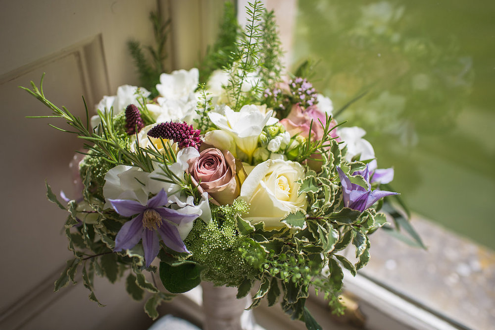 Bridal bouquet with peonies, Amnesia roses, clematis and garden herbs, Harewood House, Bucks