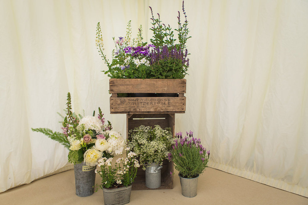 Flowers & Vintage Crates display for summer marquee wedding at Dorton House, Buckinghamshire