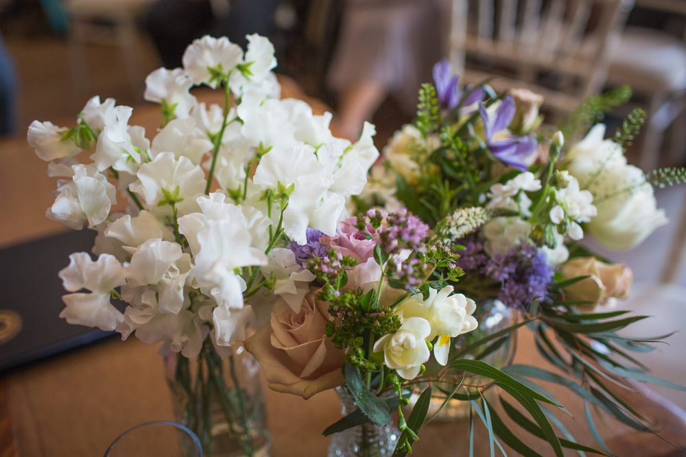 Summer flowers in bud vases at marquee wedding, Dorton House, Buckinghamshire
