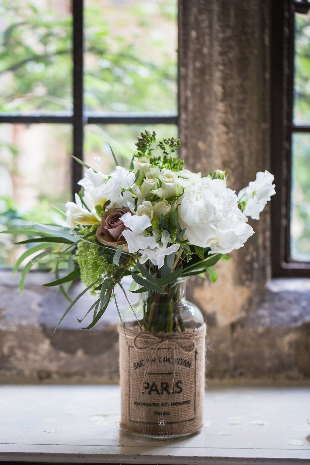 Rustic jar of wedding flowers