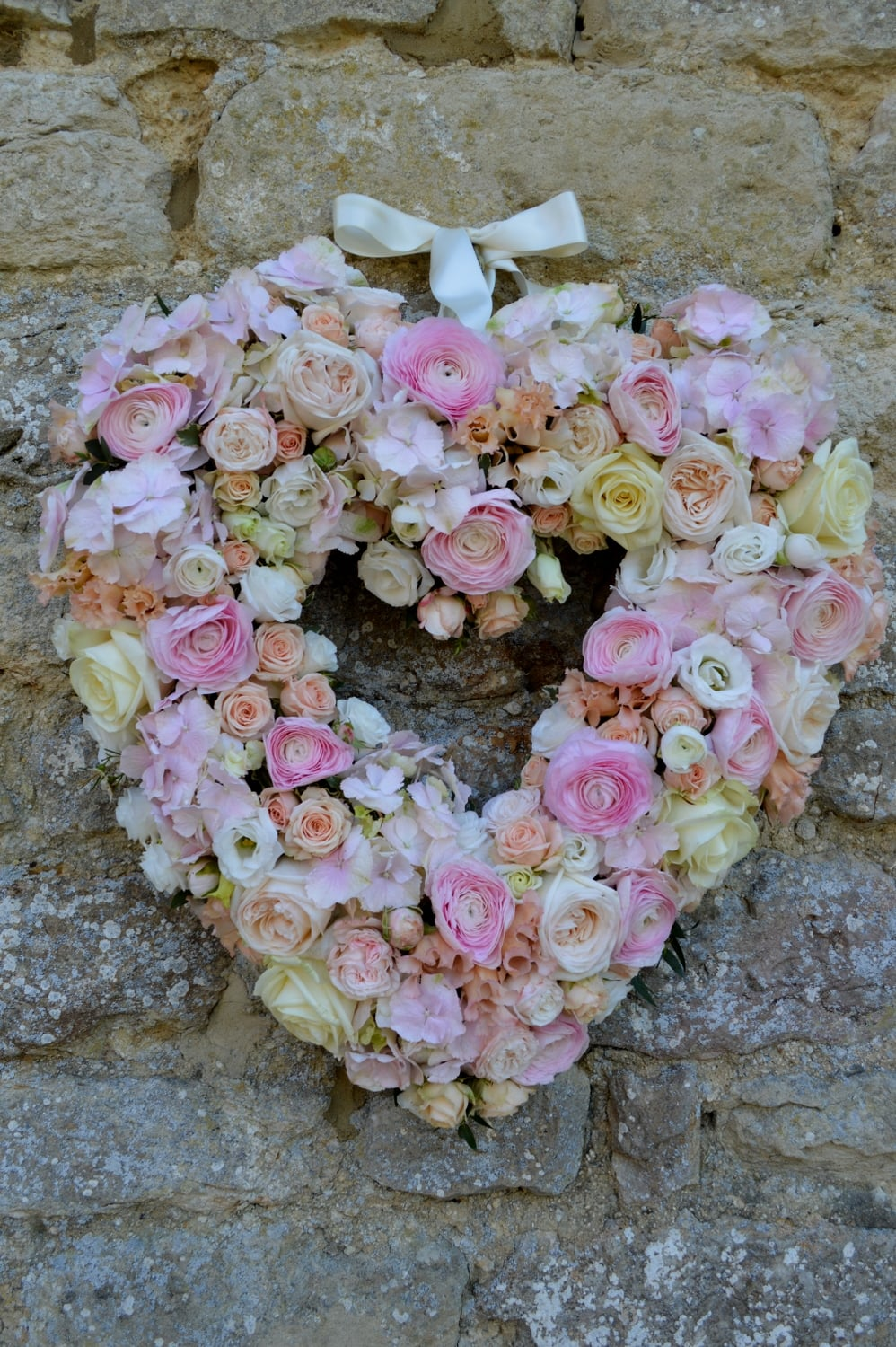 Floral heart with pale pink roses & ranunculus