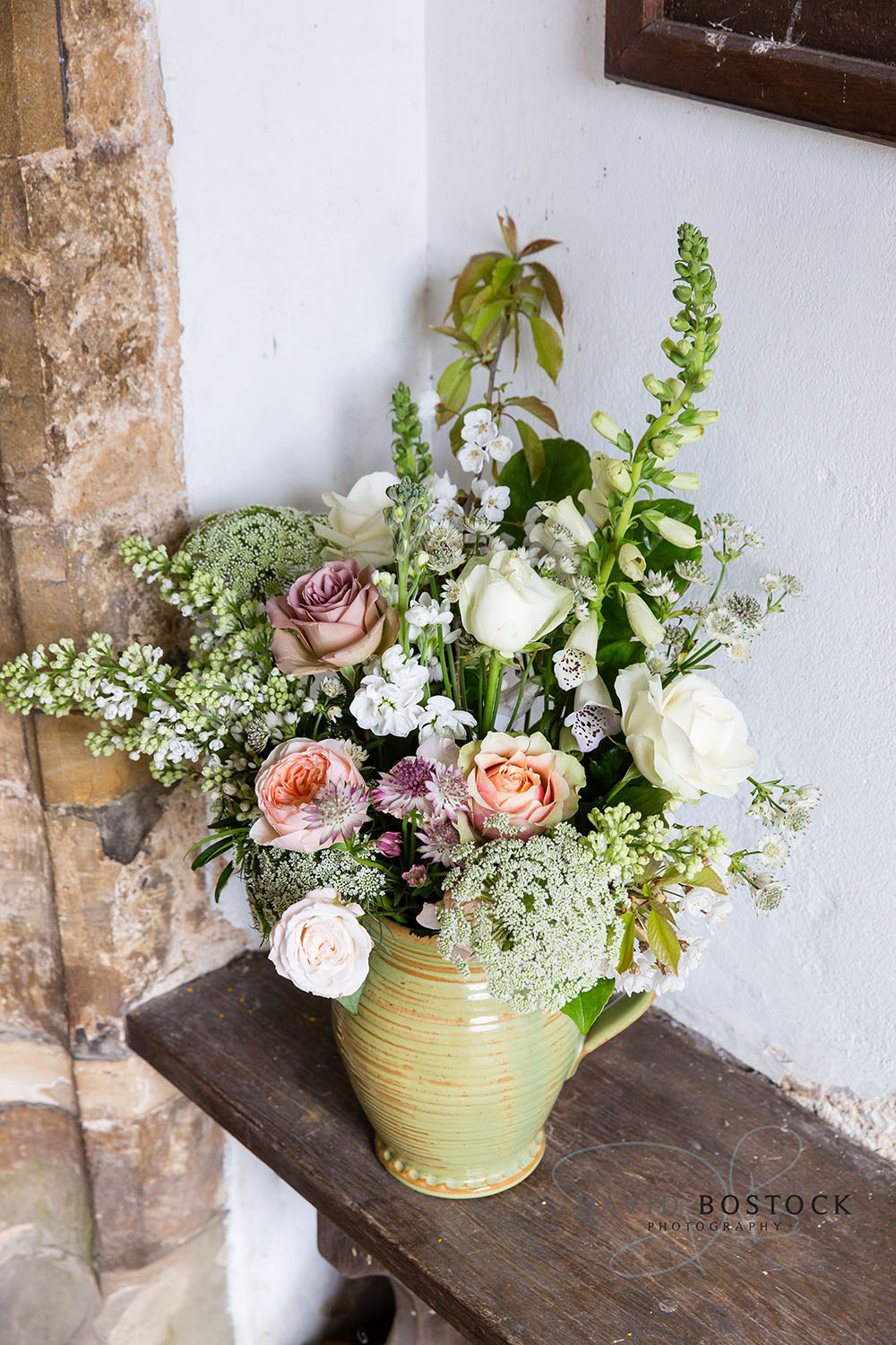 Jug of country flowers in church porch