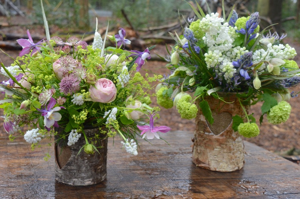 Spring wedding flowers in bark vases