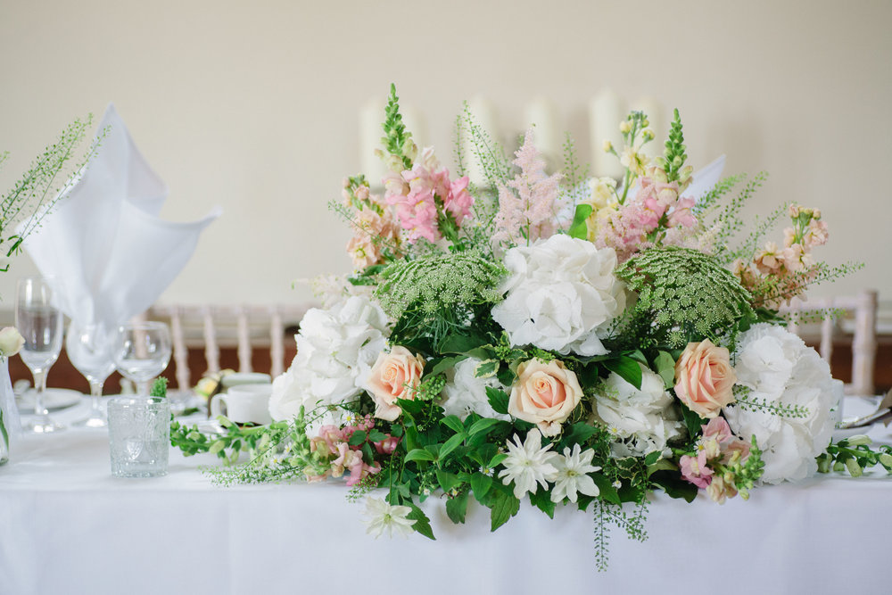 Pastel spring top table flowers at Nether Winchendon House Buckinghamshire