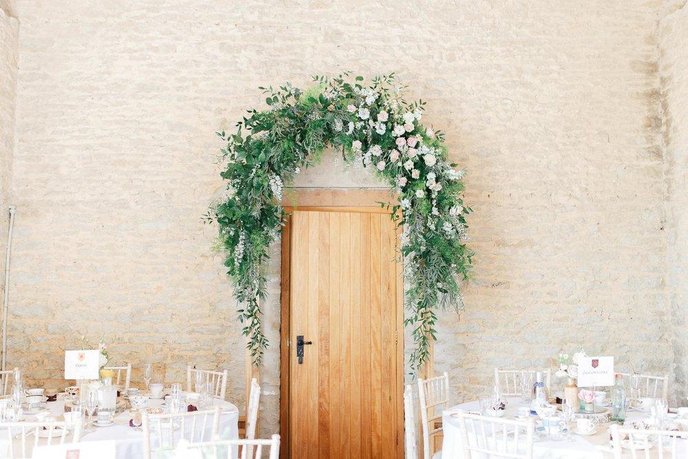 Blush spring floral arch