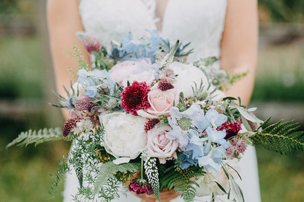 Woodland inspired spring bridal bouquet in soft pastels