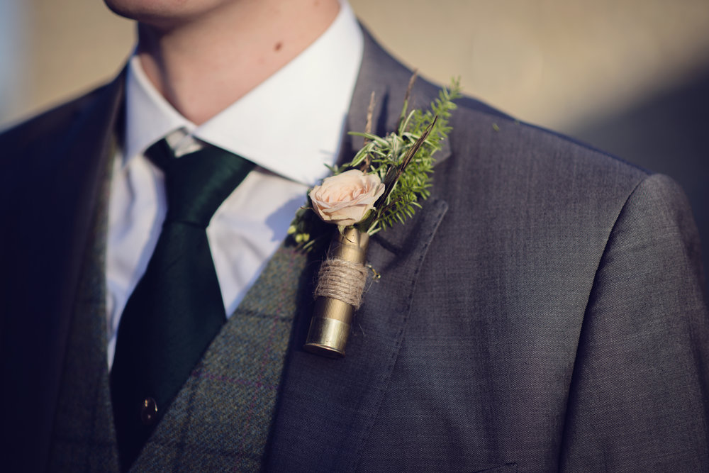 Gun cartridge buttonhole