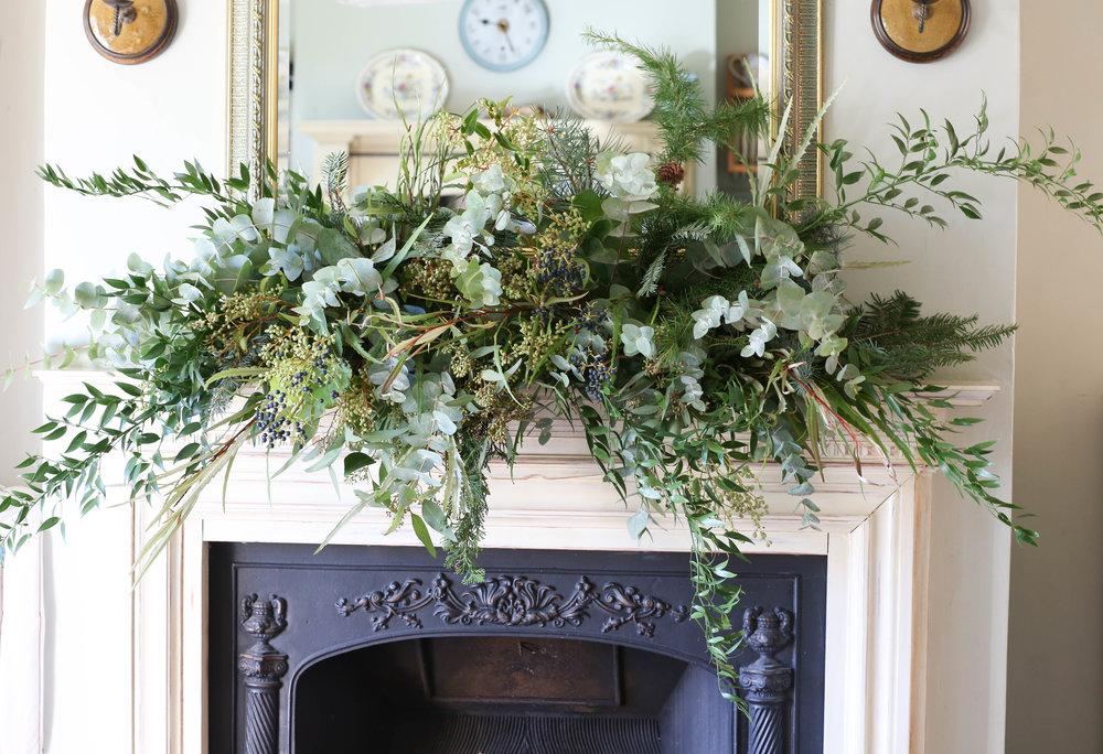 Festive eucalyptus fireplace garland