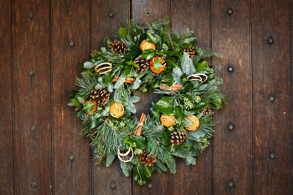 Christmas wreath with cones and oranges