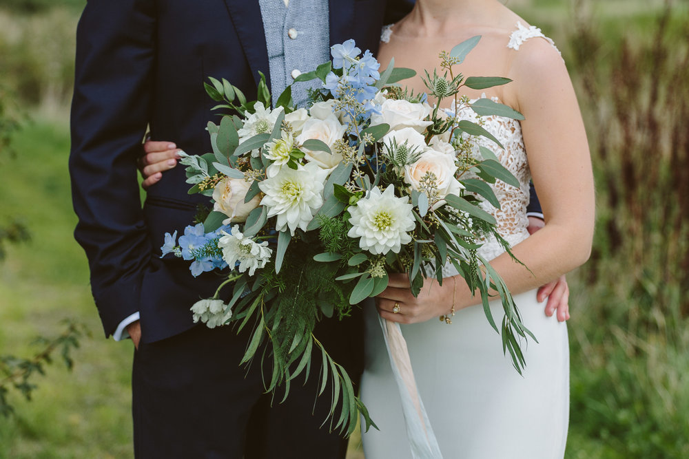 loose, unstructured white and pale blue summer bridal bouquet