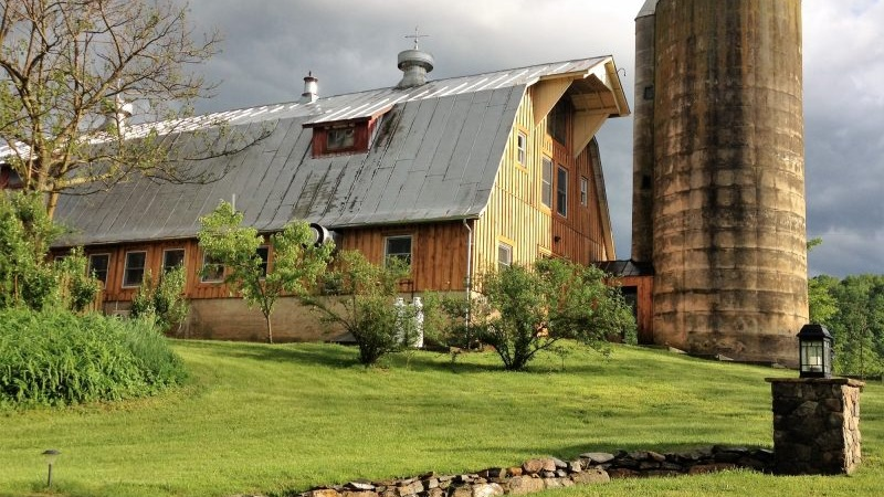 This beautifully renovated vintage barn is our magical shared space - we have yoga in the hayloft! - and it houses the dorm loft rooms and suites.