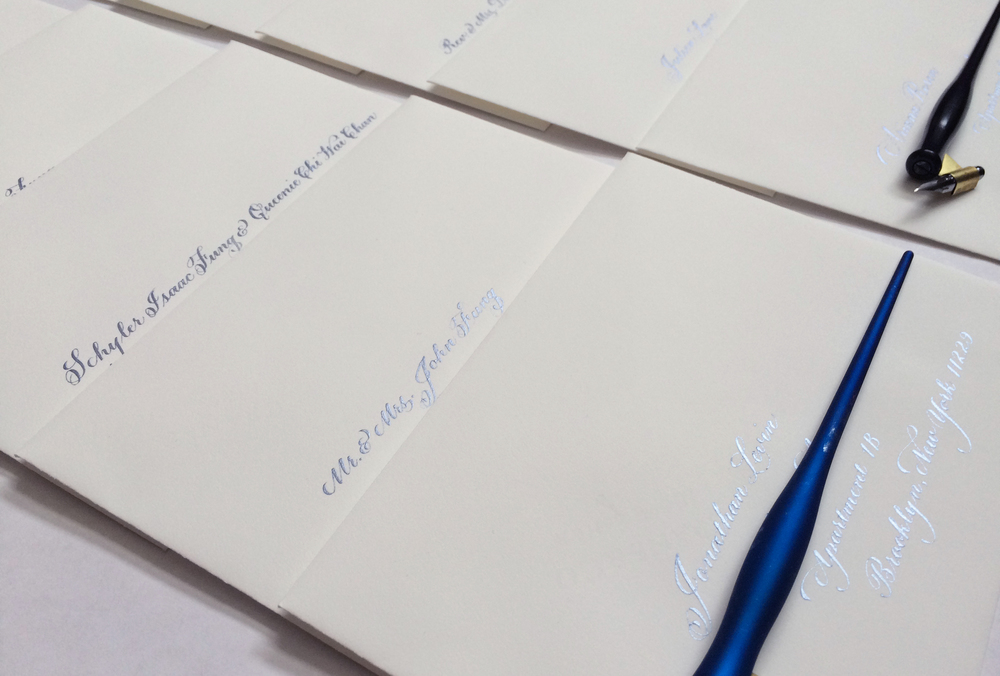 The soft sheen of blue: the hydrangea ink on the wedding envelopes.