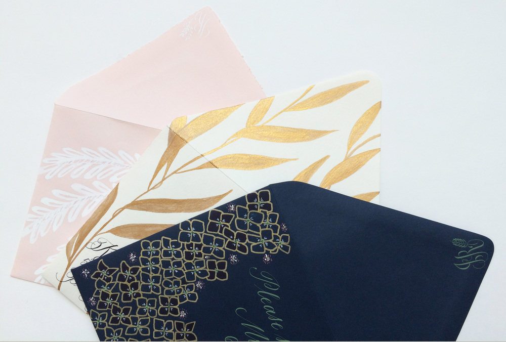 Illustrated envelopes with leaf and floral motifs