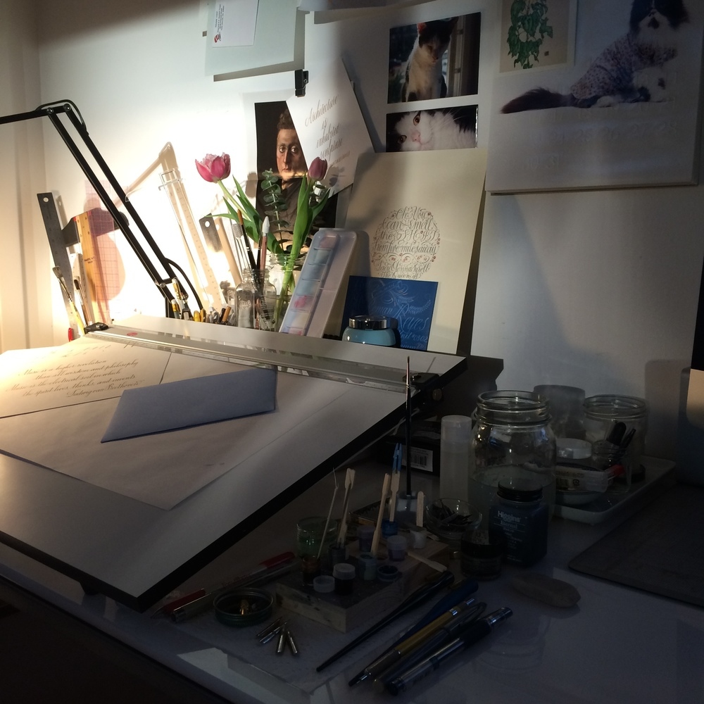 Soft evening light on my very messy desk.