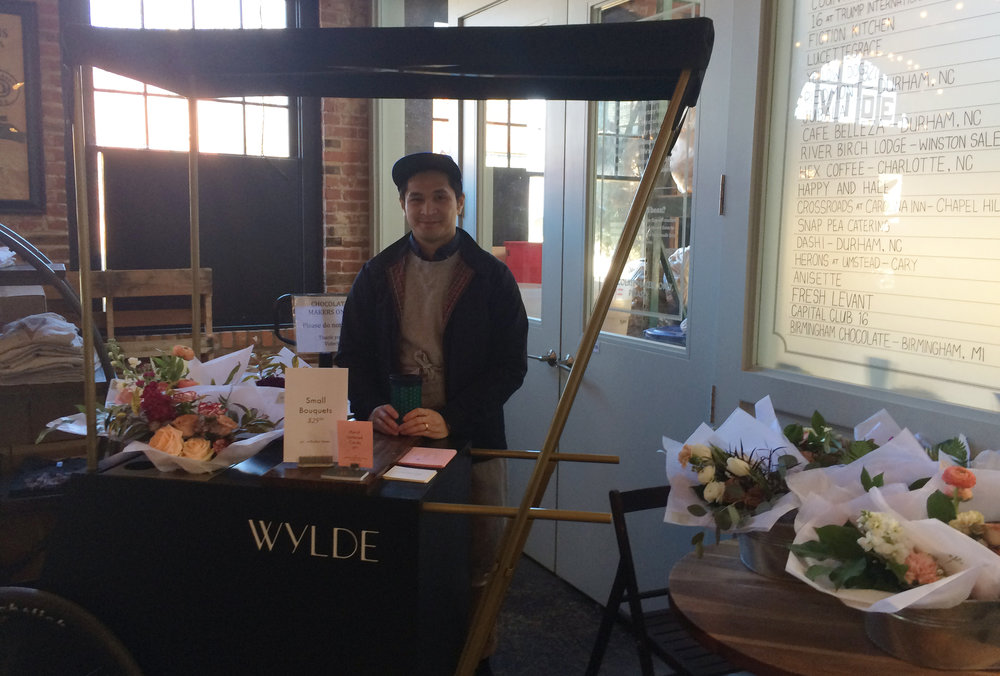 My brother and Nikelle's husband Gino selling bouquets at  Videri  Chocolate Factory.