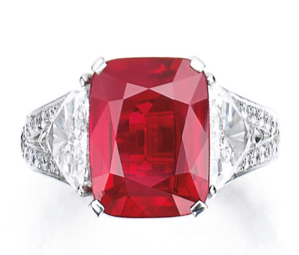 The cushion-shaped ruby weighing 8.62 carats, set between triangular diamond shoulders within a mount decorated throughout with brilliant-cut diamonds,   size 59, signed Graff, together with an alternative ring mount, Graff. Photo Courtesy of Sothebys