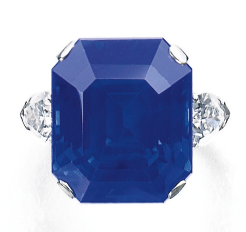 The step-cut sapphire weighing 27.54 carats, set between pear-shaped diamond shoulders  , size 53, together with an alternative ring mount, Graff. Photo Courtesy of Sothebys