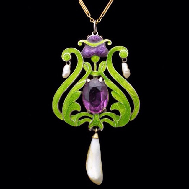 Child & Child Women's Suffrage necklace circa 1908, featuring amethyst, pearls, and green enamel work on gold.