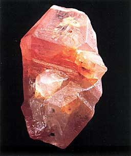 Sri Lankan padparadscha sapphire crystal,  8 by 5 cm; Collection: Paul Ruppenthal Photo: Studio Hartmann From Gem & Crystal Treasures by Peter Bancroft