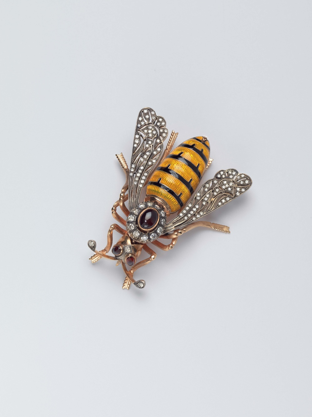 "Bee, Designer Unknown, USA. c. 1980.  Photo by John Bigelow Taylor.For a meeting with Yasser Arafat, Albright wore this bee pin. She writes, ""I spent manyhours wrangling with the Palestinian leader about the need for compromise in the MiddleEast. My pin reflected my mood."" (He sent her a butterfly.)"