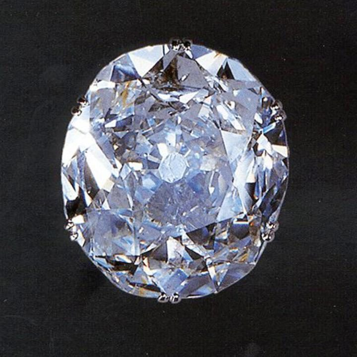 "The massive Kohinoor diamond is thought to have been mined in southern India in the 1300s. Over the centuries it changed hands many times passing from Mughal emperors, Afghan warlords and Indian Maharajas. Because of the tragic and bloody fates of previous owners the Kohinoor, which means Mountain of Light, came to be feared as ""cursed"". The 105 carat jewel was in the possession of the rulers of Punjab's Sikh Empire when the Anglo-Sikh wars broke out in the late 1840s."