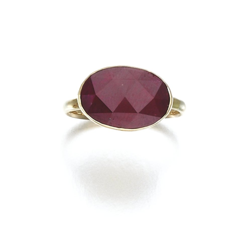 Collet-set with a faceted oval ruby. Photo by Sotheby's Auction House.