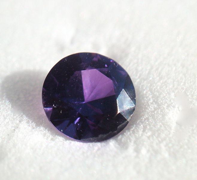 0.37 carat, purple Yogo sapphire from Yogo Gulch, Montana.PHOTO BY PUMPKINSKY