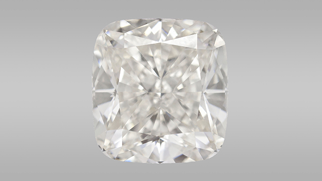 This 5.19 ct CVD synthetic diamond (10.04 × 9.44 × 6.18 mm, with J-equivalent color and VS2-equivalent clarity) is the largest GIA has identified to date. Photo by Johnny Leung and Tony Leung.
