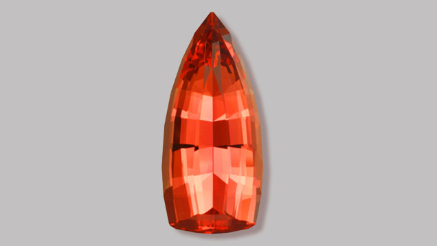 Spectacular prize-winning, orangy-red, flame-shaped Imperial Topaz gem. (Photo: Gem courtesy of John Dyer & Co.)