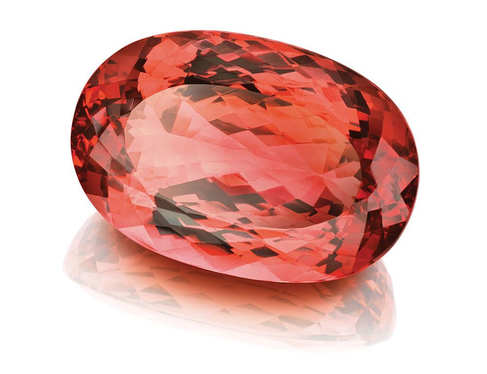 THIS UNTREATED 45-CARAT IMPERIAL TOPAZ DISPLAYS AN ATTRACTIVE REDDISH PEACH COLOR. (PHOTO: CONSTANTIN WILD, IDAR-OBERSTEIN)