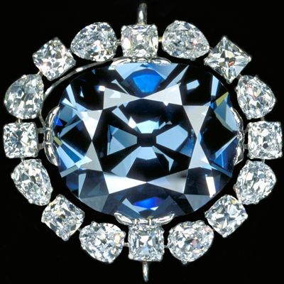 The Hope Diamond 45.52 carat blue diamond surrounded by white diamonds.