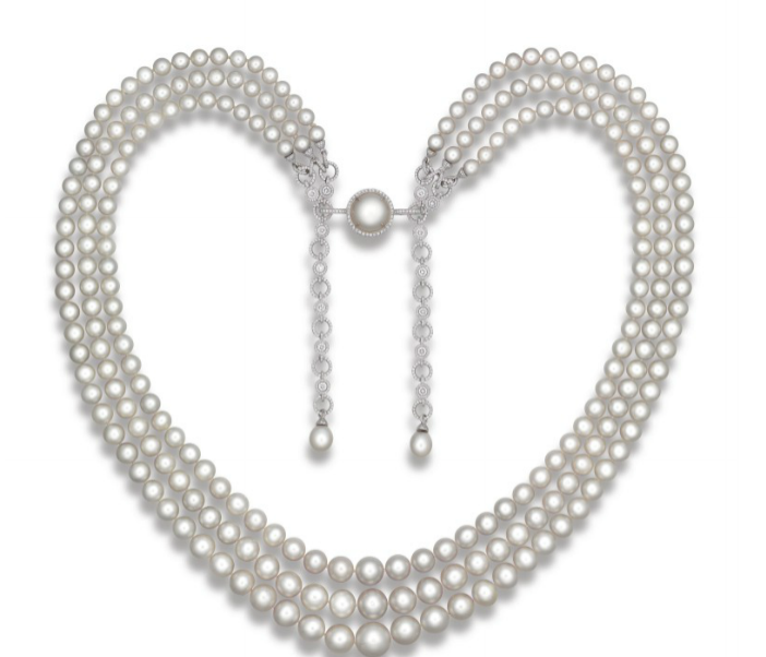An exceptional natural pearl and diamond necklace, by Paspaley. The three-strand necklace composed of two hundred thirty-seven natural pearls gathered by a button-shaped natural pearl surrounded by circular-cut diamonds.