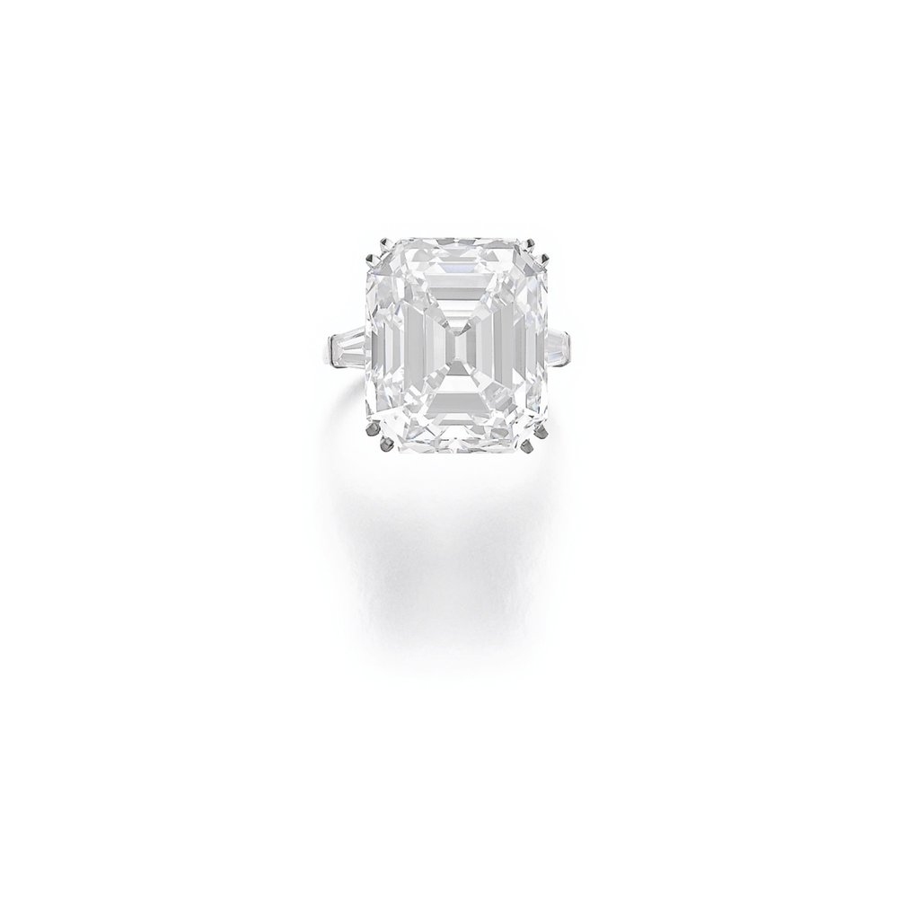 Important diamond ring by Van Cleef & Arpels. Set with a step-cut diamond weighing 21.60 carats, between tapered baguette diamonds.