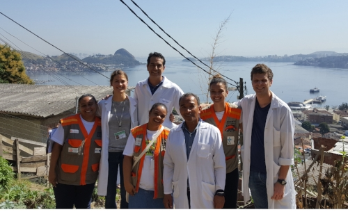 Robbie Snyder and Claire Boone with Brazilian healthcare workers working in a slum neighborhood in Niteroi