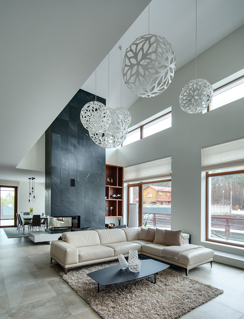 A home in Kiev, spotlighted by Design Milk, features five David Trubridge lights.
