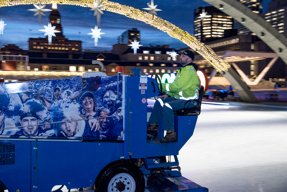 Aaaah the Zamboni driver paying close attention to his work.