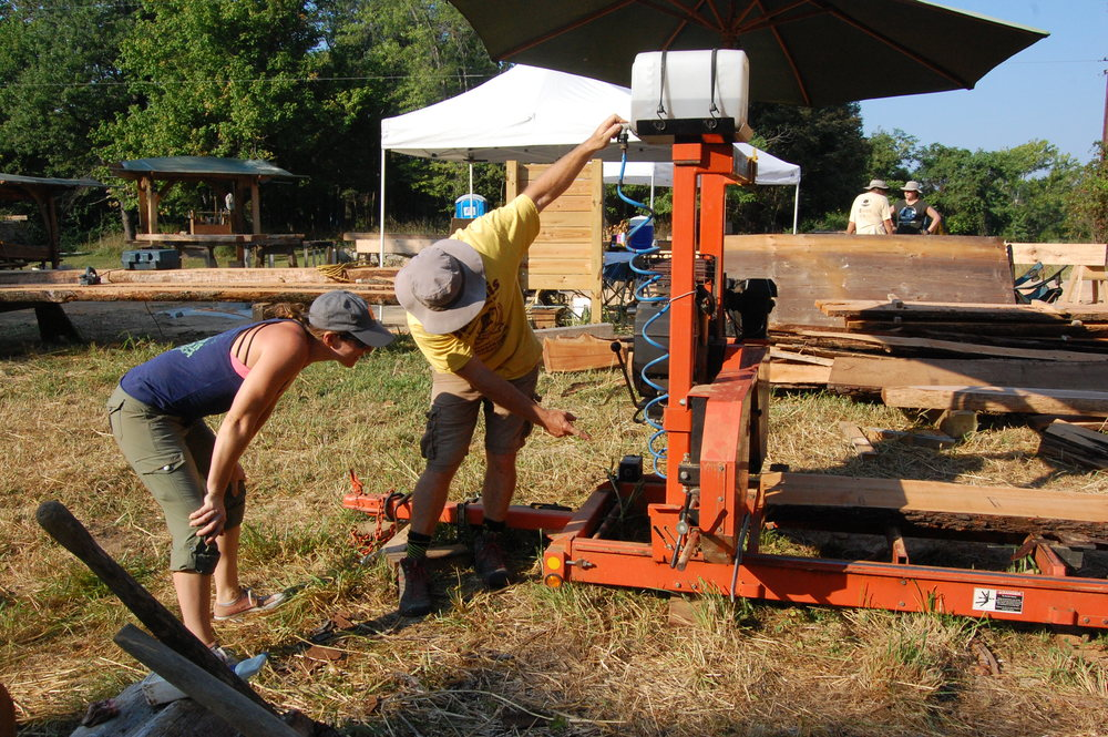 Pat gives Katie a lesson on the Wood-Mizer portable sawmill...