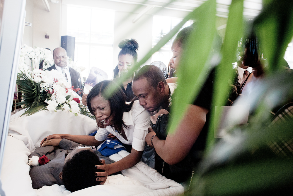 The parents of 13-year-old shooting victim Ronald Wallace at his funeral, 2012.