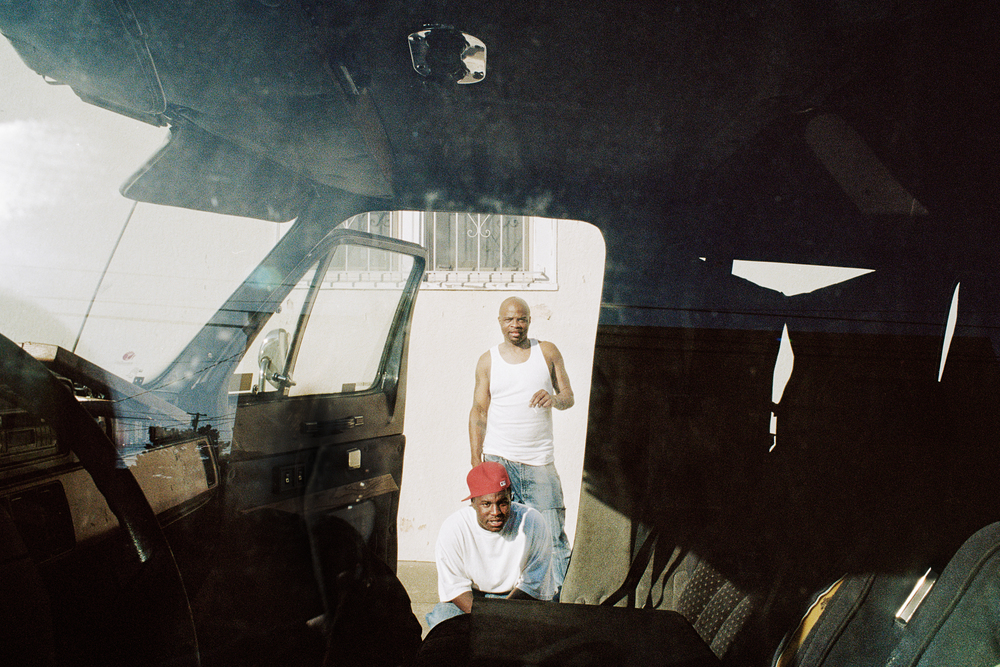 Norris and Ricky fixing the van, 2009.