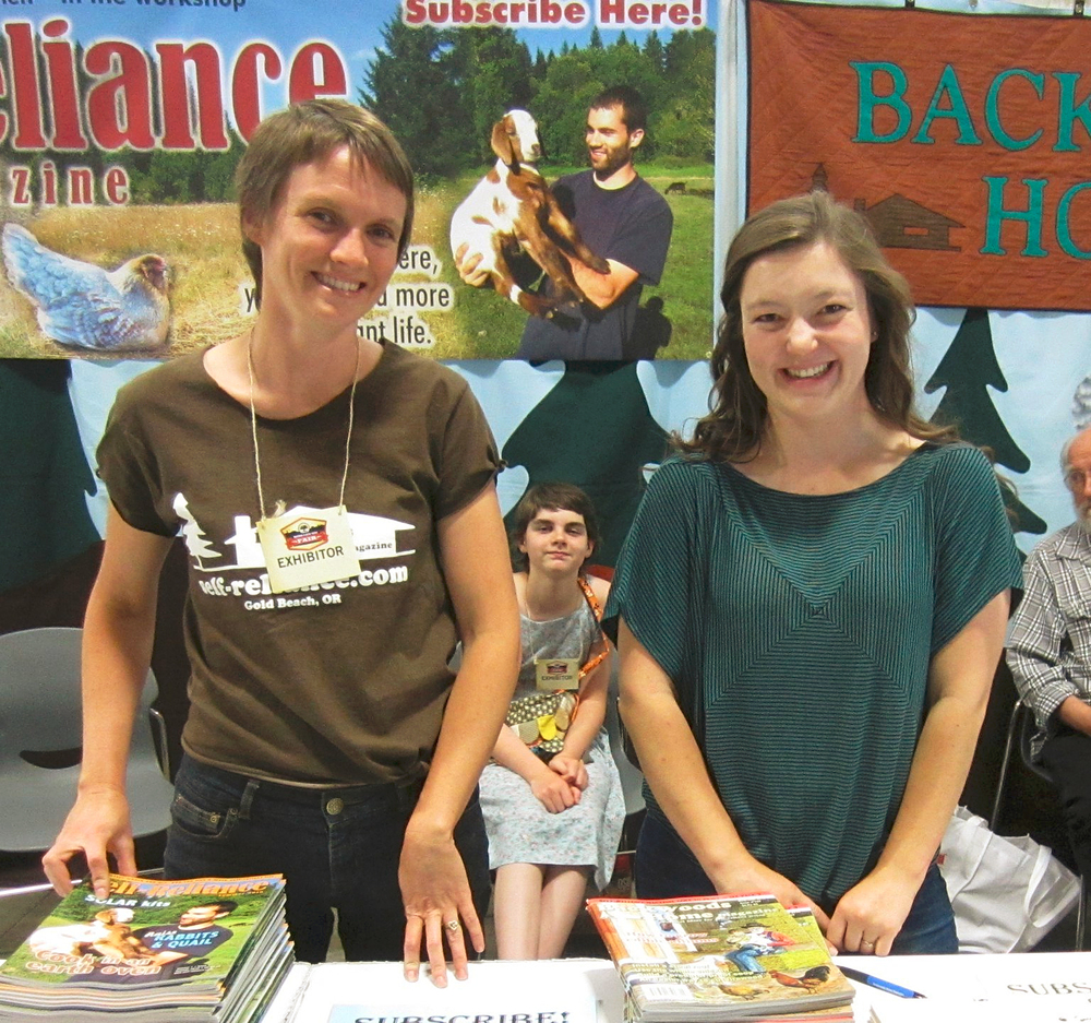 Jessie Denning (right), Managing Editor of Backwoods Home magazine and Annie Tuttle (left), Managing Editor of Self Reliance magazine, at the Backwoods Home / Self Reliance booth. I had meant to get a photo taken with them but forgot. I could have Photoshopped myself in later but, well, that would be creepy. Photo by Dave Duffy.
