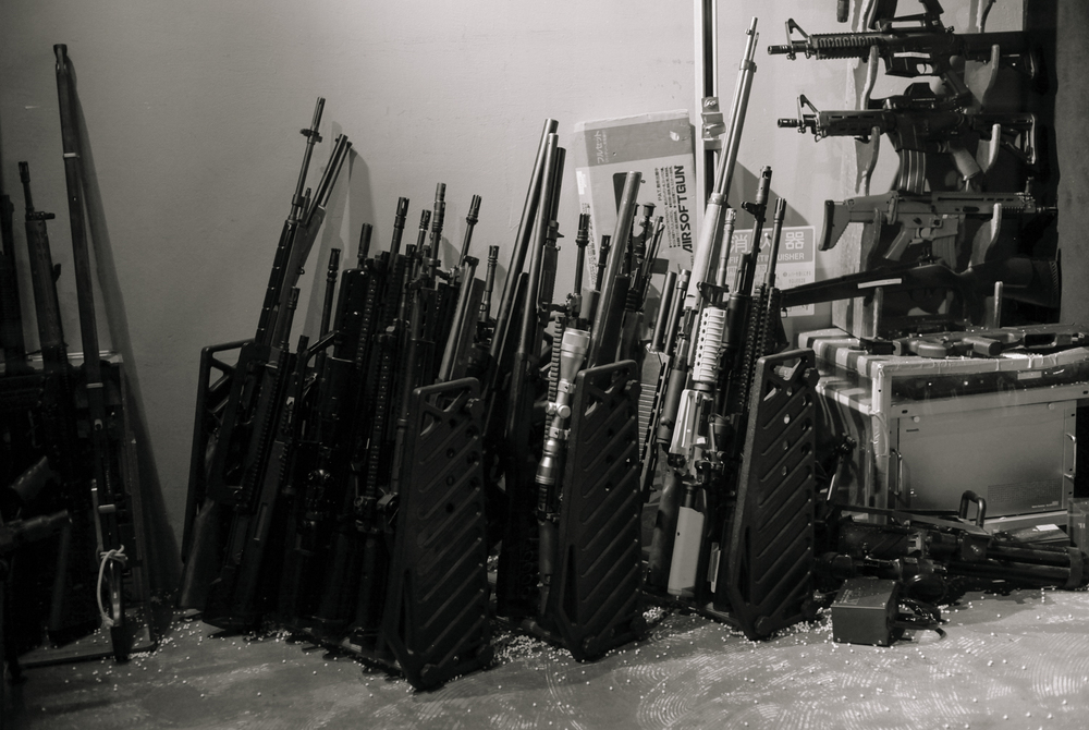 The vast arsenal of guns at the bar.