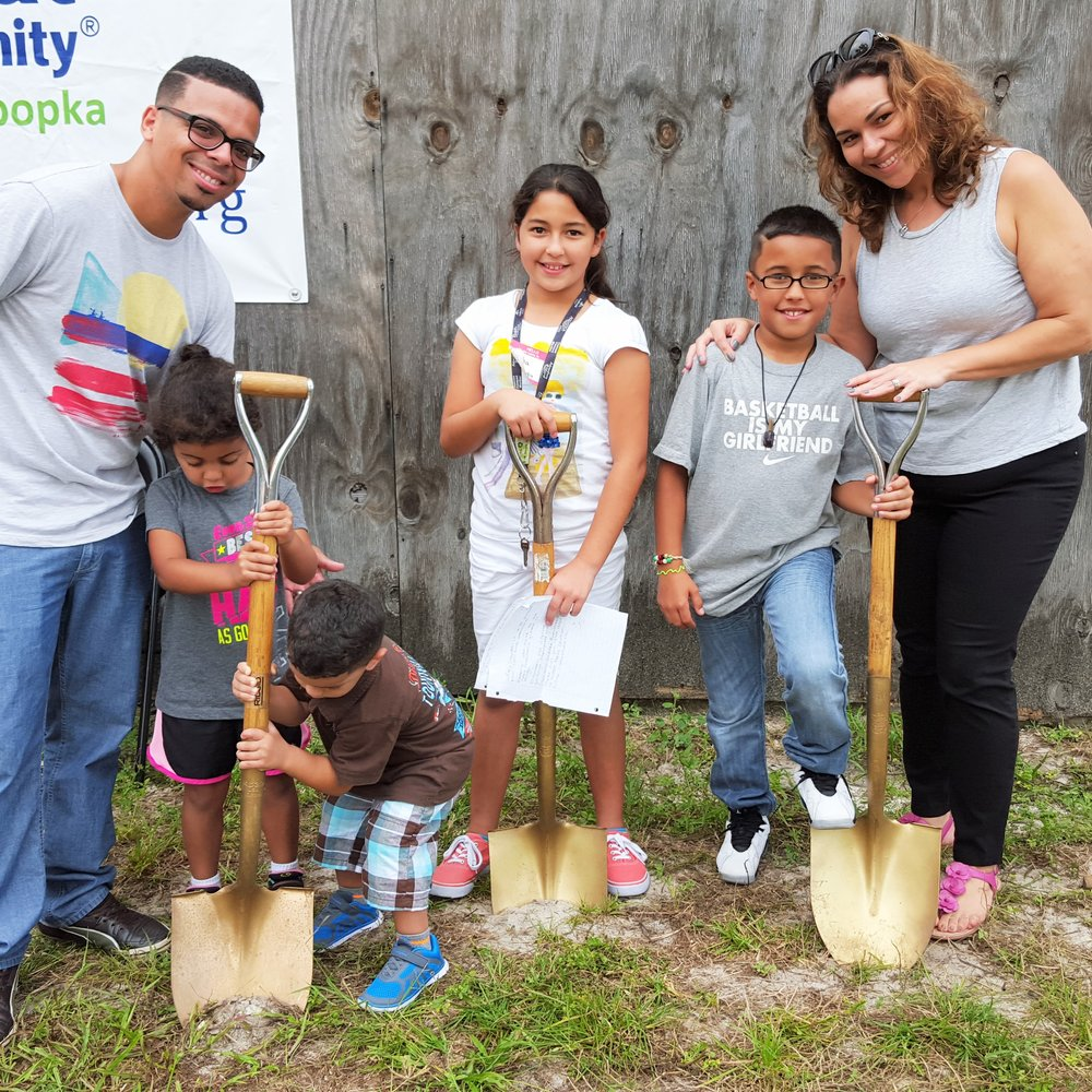 Kalesha, Raul, and their four children at the groundbreaking for their new home