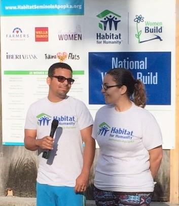 Raul and Kalesha welcoming volunteers to a build day.
