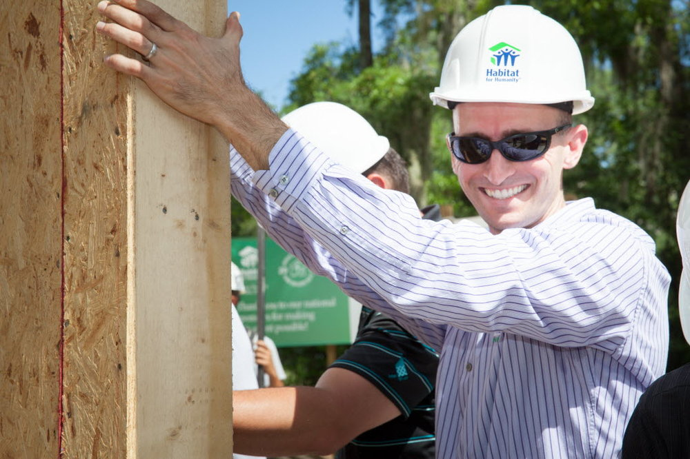 Rob Smith, President of E2 Homes, helps to raise a wall during the opening ceremony of Home Builders Blitz 2015. His company joins Habitat Seminole-Apopka again this year to complete a home in Sanford during Home Builders Blitz.