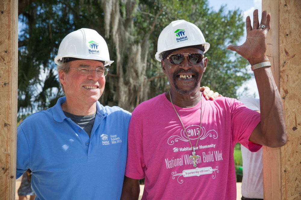 Steve Thomas, the former host of This Old House and Renovation Nation, and new Habitat homeowner Clarence Grayson during the opening ceremony of Home Builders Blitz 2015.