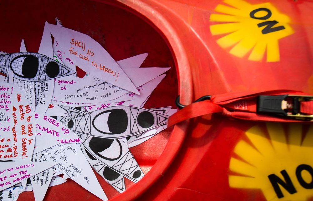 "Paper Kayaks with notes protesting the planned arrival of Shell's oil drilling rig pile up in a kayak waiting to be transported to the Port of Seattle during a protest at Myrtle Edwards Park on Sunday, April 26, 2015. Hundreds gathered for the ""Shell No: Seattle Draws the Line"" protest organized by various organizations to combat increased climate change and possible damage to the Arctic."