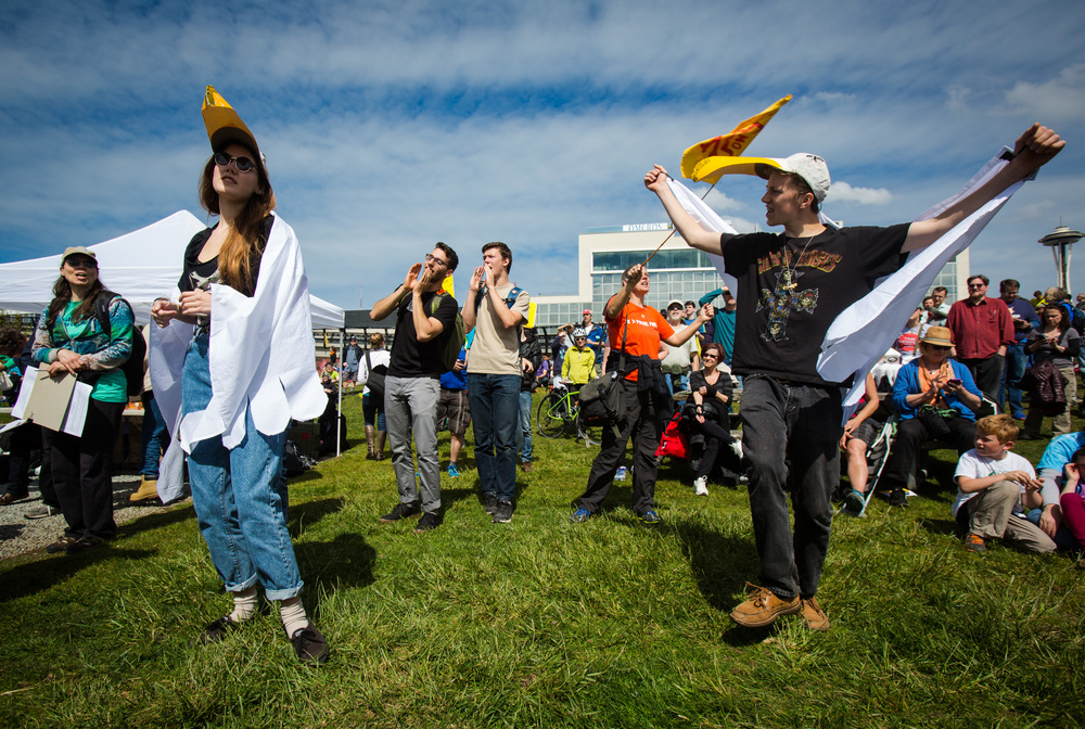 "Reve Hansen and Whealon Costello dance in seagull hats and capes in protest against the planned arrival of Shell's oil drilling rig at Myrtle Edwards Park on Sunday, April 26, 2015. Hundreds gathered for the ""Shell No: Seattle Draws the Line"" protest organized by various organizations to combat increased climate change and possible damage to the Arctic."